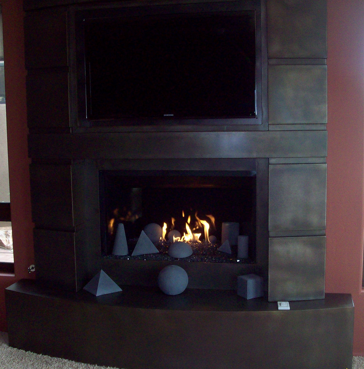 Craftsman Fireplace with Porcelain Panels and Geo Shapes with Glass