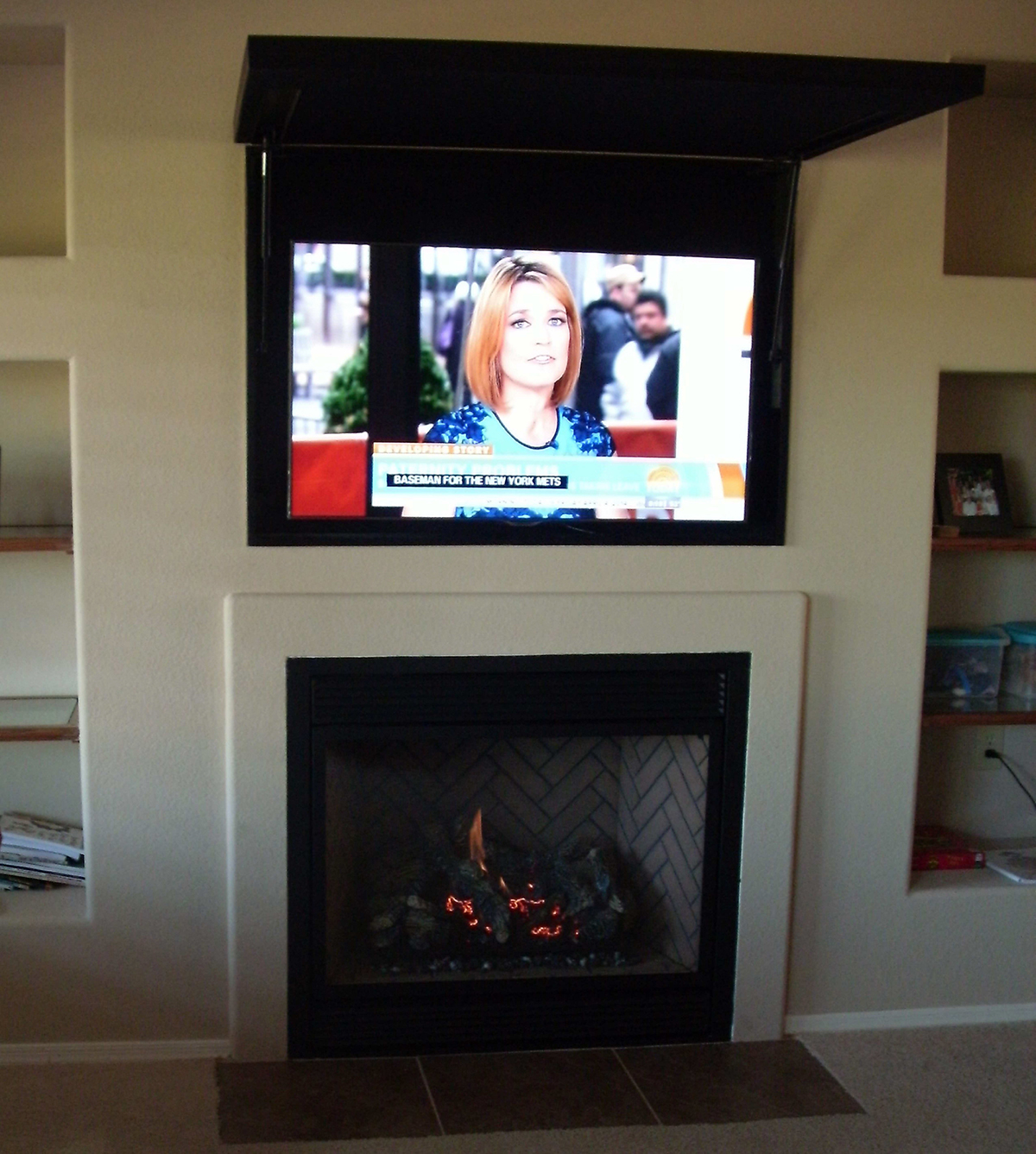 Fireplace Xtrordinair with TVCoverUp opened above fireplace